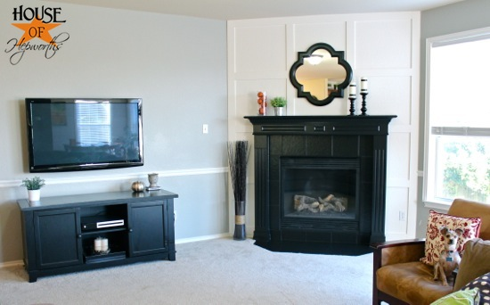 A dramatic fireplace makeover white moulding & black mantel