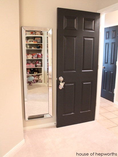 Trend I really love the elegant mirror paired with the black door and the brushed nickel doorknob