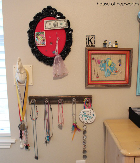 Best Kinsey inherited the chicken head which now proudly displays her medals leftover cruise key card and long necklaces
