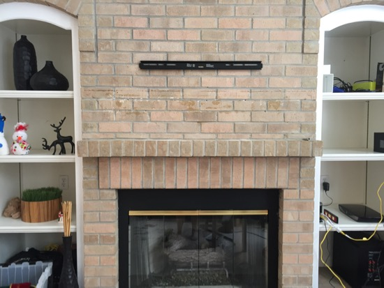 Tv On Brick Above A Fireplace, Attaching Tv Mount To Brick Fireplace