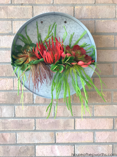 metal round wall planter with faux succulents